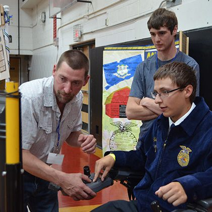 Assisting students at a Future Farmers of America workshop